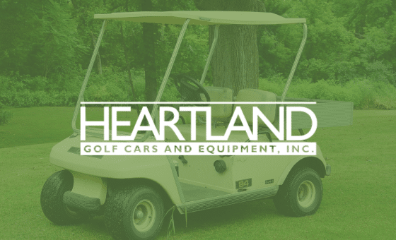Heartland logo with a golf cart on a golf course